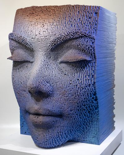 Meditative Faces Emerge from the Staggered Wooden Sticks Forming Artist Gil Bruvel's Sculptures