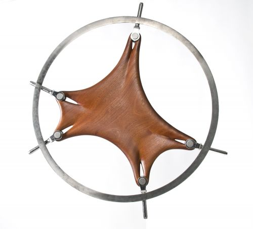 Carved Wood Sculptures by Phil Young Appear to Stretch, Twist, and Tear Within Metal Armatures