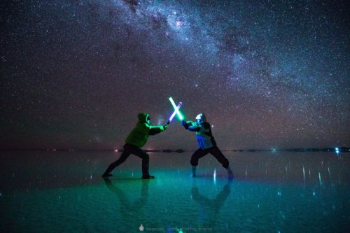 Photos of a Starry Lightsaber Duel in the World's Largest Salt Flat