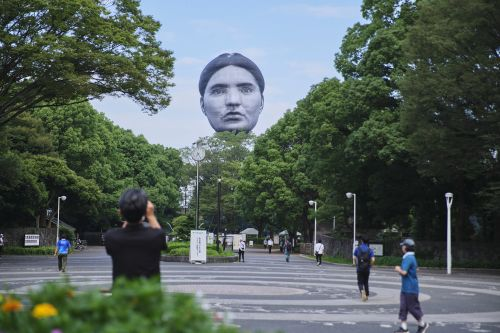 Massive Human Faces Loom Over Japanese Cities in Uncanny Balloon Works by Mé