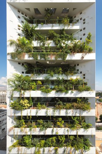 Lush Greenery Fills Pixelated Openings and a Vertical Landscape in Jean Nouvel's Tower 25