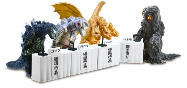 Japanese Monster Figurines Apologize For Their Destruction at Press Conference Podiums
