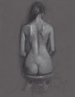 Backside of a nude girl seated on a chair
