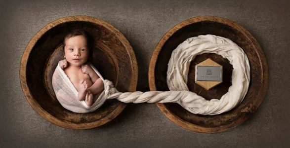This Newborn Photo Shows a Baby and His Twin Brother's Ashes