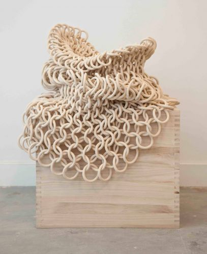 Hundreds of Ceramic Circles are Linked Together in Movable Sculptures by Cecil Kempernik