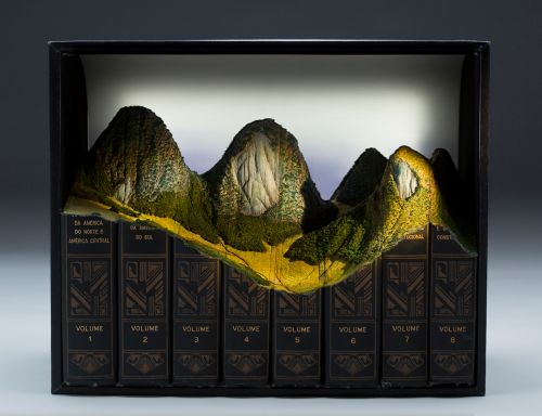Mountainous Landforms Top Carved Book Configurations by Guy Laramée