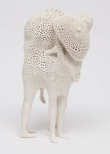 Abstract Masses of Porcelain Consume Embracing Figures in Sculptures by Artist Claudia Fontes