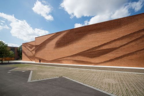 An Undulating Brick Facade Imitates the Free-Flowing Movement of Draped Fabric