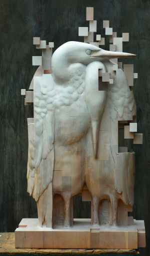New Figurative Wooden Sculptures by Han Hsu-Tung Dissolve Into Pixelated Cubes