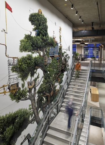 A Three-Story Tree Acts as a Scaffold for a Growing Community in a Mural by Ethan Murrow