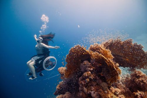 A Specially Adapted Underwater Wheelchair Brings Artist Sue Austin Beneath the Earth's Surface