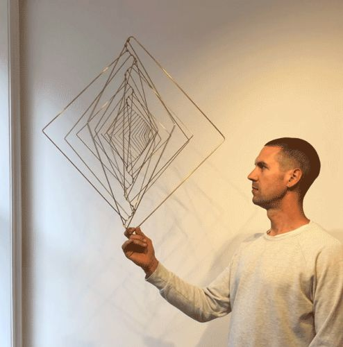 A Kinetic Sculpture Twists and Morphs Based on the Fibonacci Sequence