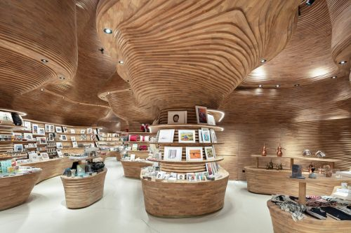 A Geological Landmark's Phosphorescent Glow Inspires the National Museum of Qatar's Cavernous Gift Shop