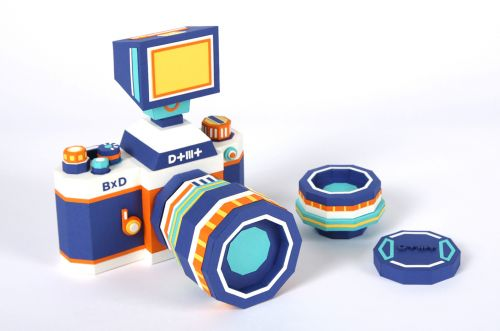 A Paper Camera Comprised of Complementary Colors Includes Interchangeable Lenses and a Removable Flash