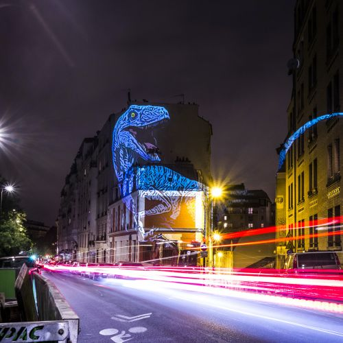 Towering Holographic Dinosaurs Stalk the Streets of Paris in Projections by Julien Nonnon