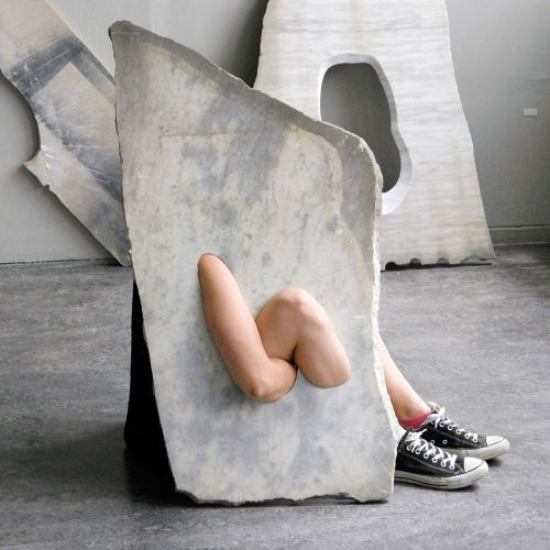 Human Limbs Mysteriously Emerge from Marble Slabs in Milena Naef's Performative Sculptures