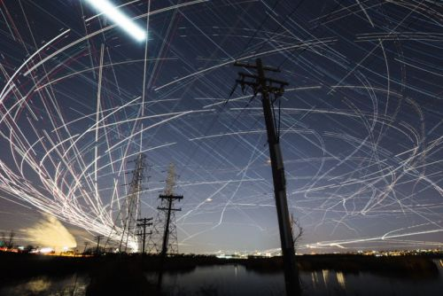 Photos of Night Skies Full of Airplane Light Trails