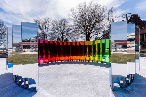 Dozens of Mirrored Prisms Respond to Movement with Dazzling LED Lights