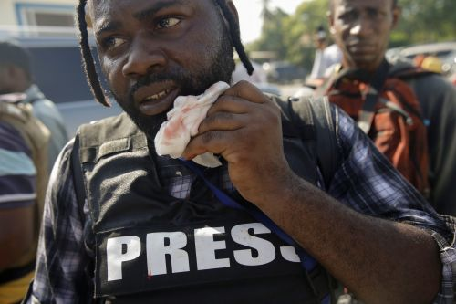 AP Photographer Wounded in Haiti when Senator Fired Gun to Disperse Protesters