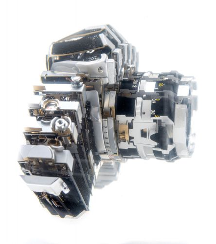 Vintage Cameras Dissected With a Saw and Suspended in Resin by Fabian Oefner