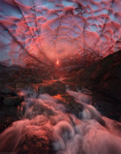 This Photo Shows an Ice Cave Being Lit by a Flare