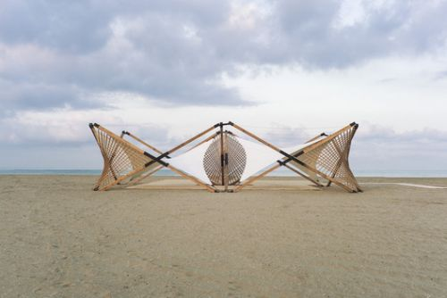 Lightweight Wooden Deployable Structure Aims for Large Social Impact Without Leaving a Mark