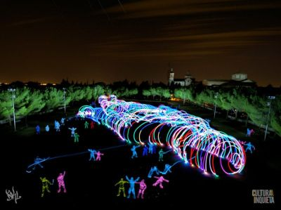 20 Light Painters Create a Giant Man Inspired by Gulliver's Travels