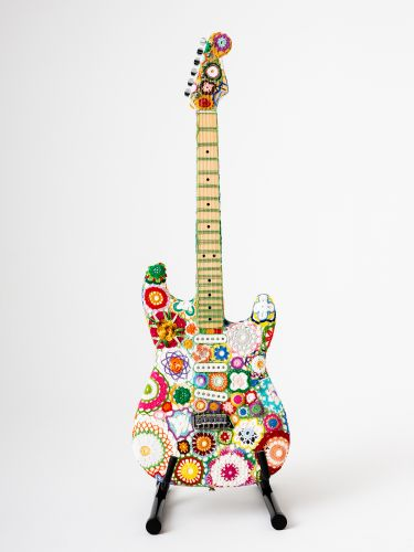 Bright Floral Knitting Wraps an Iconic Stratocaster Guitar in a Psychedelic Layer of Color