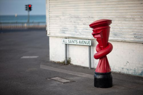 Alex Chinneck ties post boxes in knots across the UK for his latest public artwork