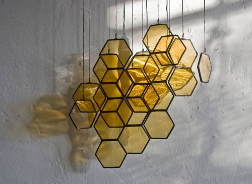 Honeycombs and Origami Cranes Dangle in Fragile Stained-Glass Suspensions by Lesley Green