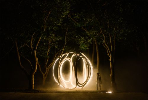 Airy, Wooden Orb Inlaid with LED Lights Radiates Throughout a Dim Forest in Taiwan